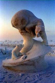 Snow sculpture of bear and cub